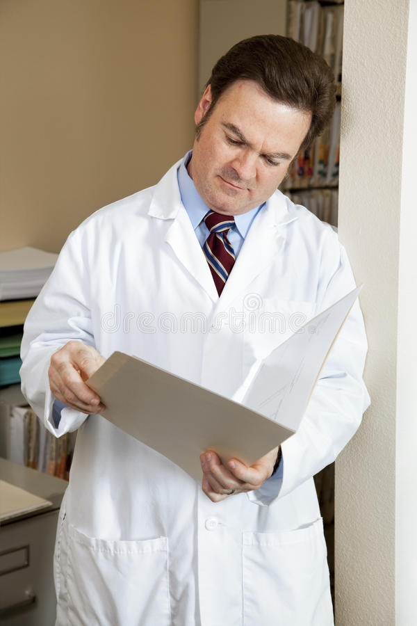 Doctor Reads Patients Chart stock images