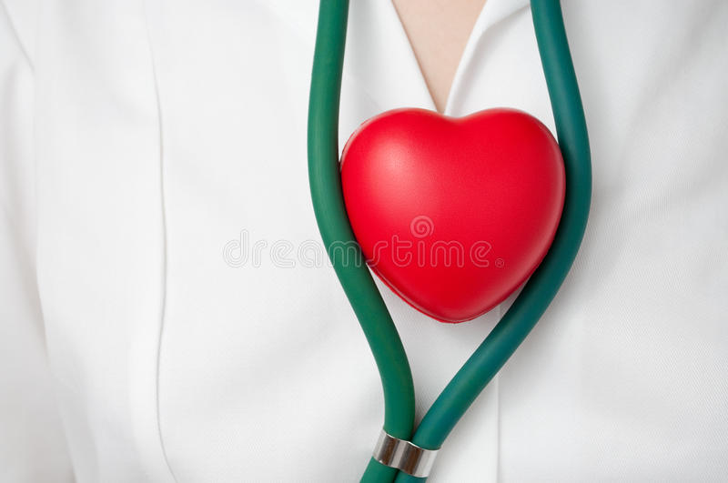 Download Doctor with red heart stock image. Image of examination - 31873705