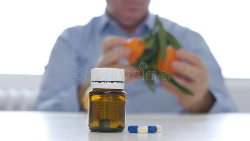 Doctor Replacing Medicament Abuse with Fresh Fruits Vitamins Consume.  royalty free stock image