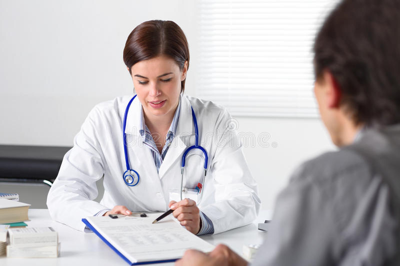 Doctor requesting the signature of a patient stock image