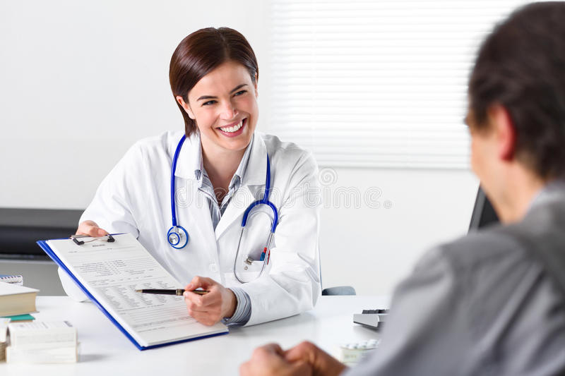 Doctor requesting the signature of a patient royalty free stock photography