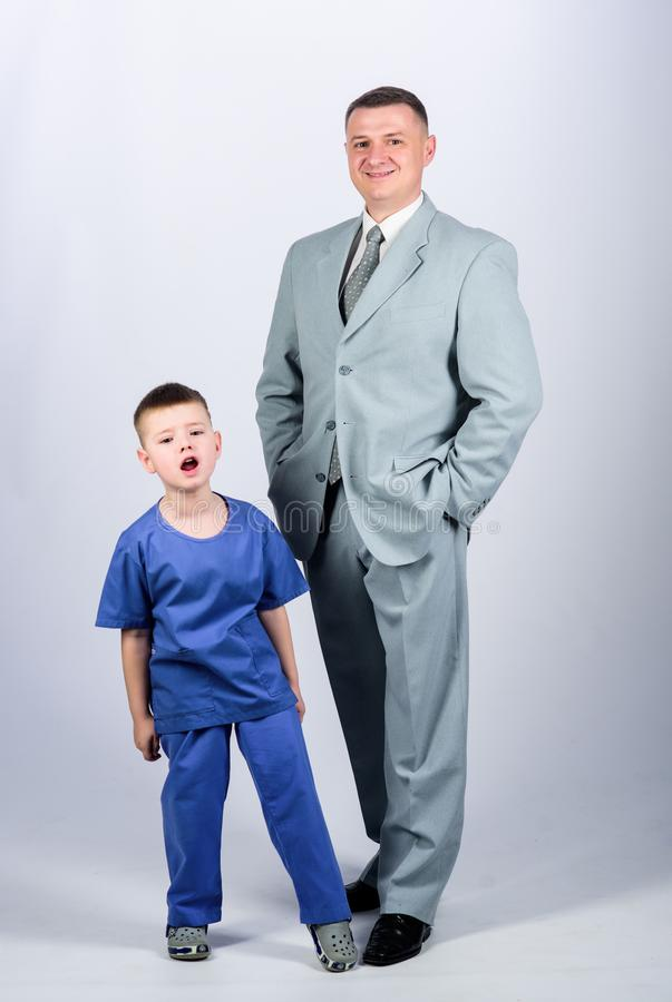 Doctor respectable career. Dad boss. Father and cute small son. Child care development upbringing. Respectable. Profession. Family business. Man respectable stock image