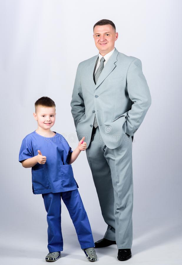 Doctor respectable career. Dad boss. Father and cute small son. Child care development upbringing. Respectable. Profession. Man respectable businessman and royalty free stock photo