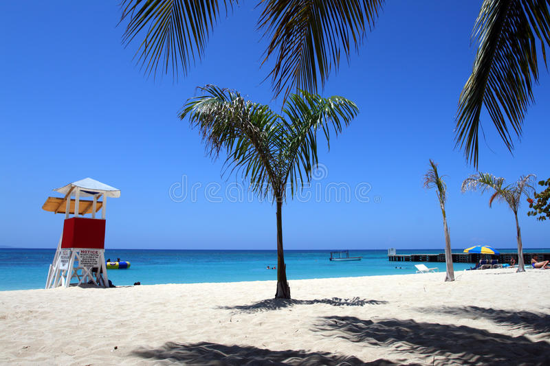 Doctor's Cave Beach, Montego Bay, Jamaica. Doctor's Cave Beach Club, Montego Bay (also known as Doctor's Cave Bathing Club) has been one of the most famous stock photos