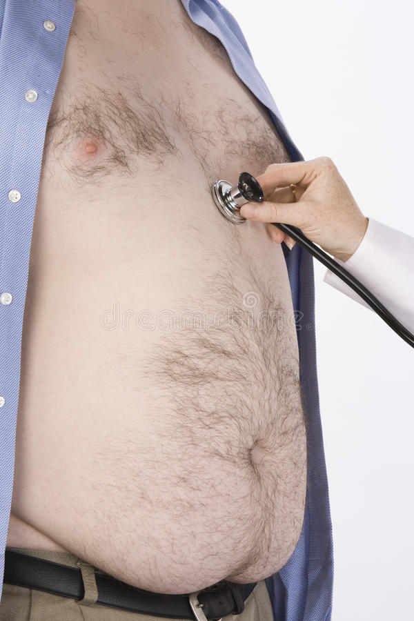 Doctor S Hand Examining Obese Man Stock Photos