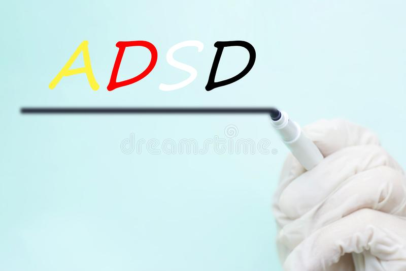A doctor`s hand in a glove with a felt-tip pen, ADHD Attention D stock photography