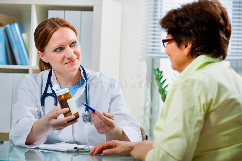 Download At the doctor's office stock image. Image of expertise - 17990389