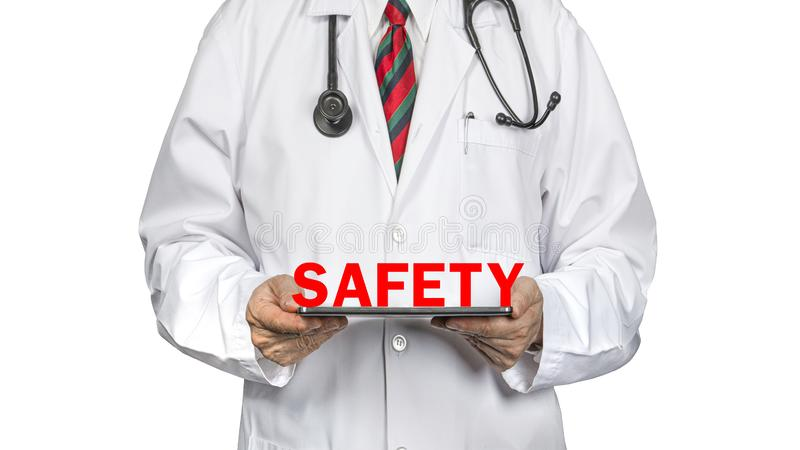 Doctor and safety banner. A doctor in white hospital gown holding safety banner.  Isolated on white background. Health issue. Hospital standards. Safety and stock images