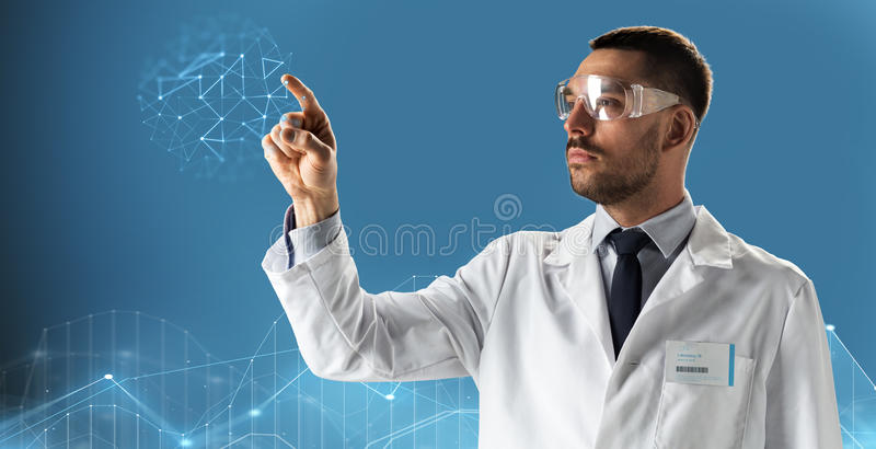 Doctor or scientist in lab coat and safety glasses royalty free stock images