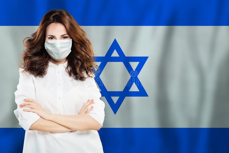 Doctor or scientist woman in medical mask on Israel flag background. Flu epidemic and virus protection in Israel concept.  royalty free stock photos