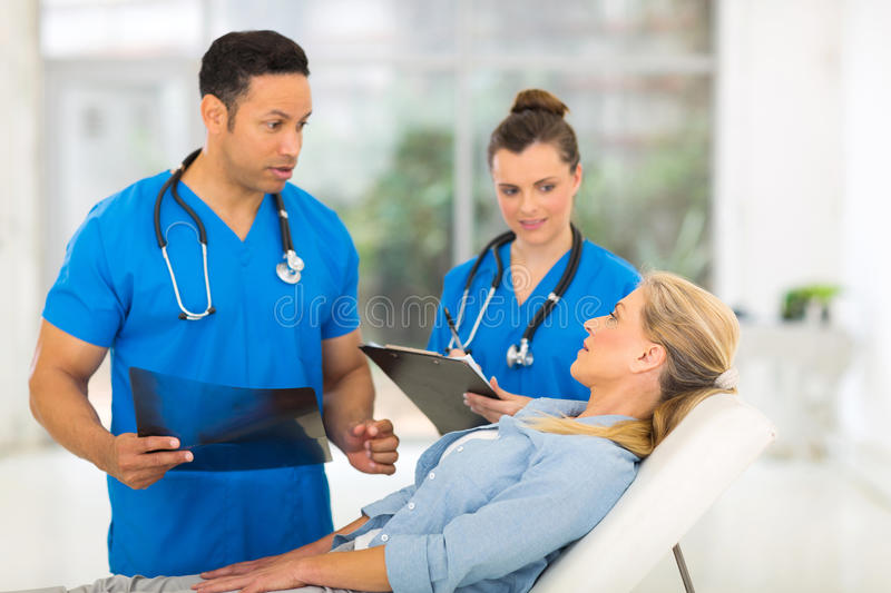 Doctor senior patient. Handsome male doctor talking to senior patient before examining royalty free stock images