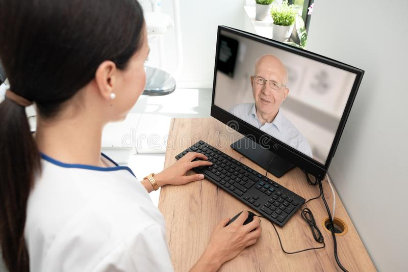Doctor and senior woman patient, telehealth. Doctor and senior men patient medical consultation, telehealth, telemedicine, remote health care concept royalty free stock photography