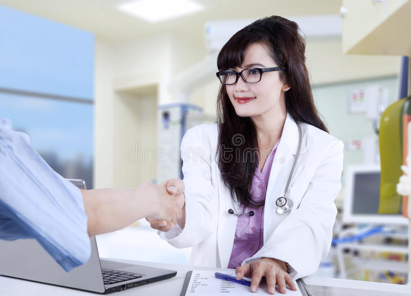Doctor shaking hands to patient royalty free stock photo