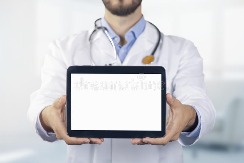 Doctor showing blank digital tablet royalty free stock image