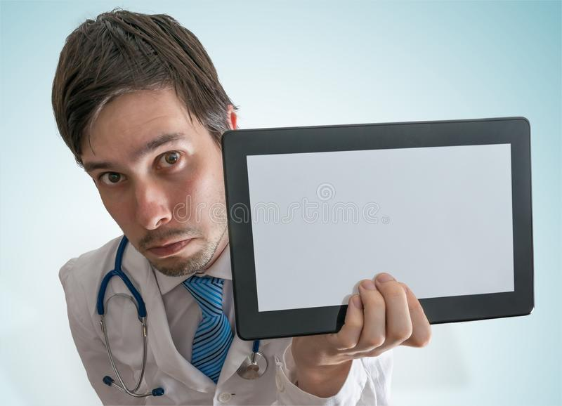 Doctor is showing blank and empty tablet for custom text.  royalty free stock images