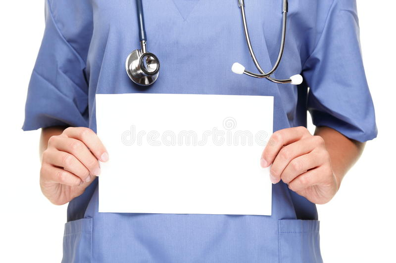 Doctor showing blank sign. Doctor or woman nurse showing blank empty sign with copy space for text. Isolated on white background stock image