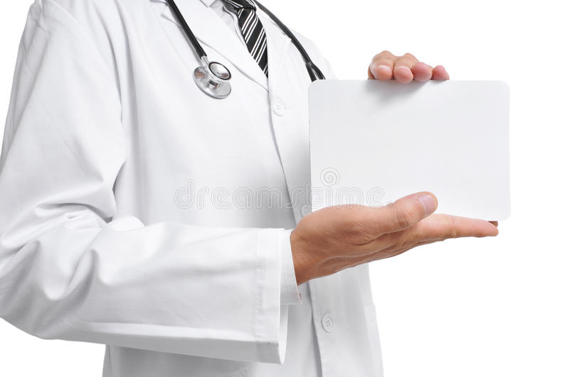 Doctor showing a blank signboard. A doctor showing a blank signboard with a copy space stock photo