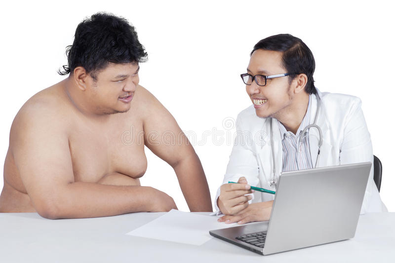 Doctor showing the check up result stock photo