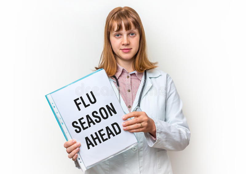 Doctor showing clipboard with written text: Flu Season Ahead stock images