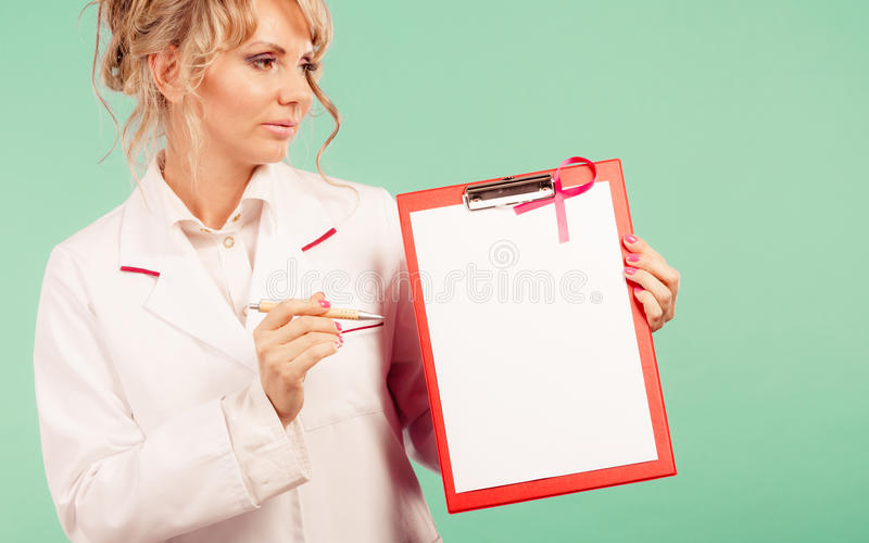 Download Doctor Showing Folder With Pink Ribbon By Pen. Stock Photo - Image: 83710900
