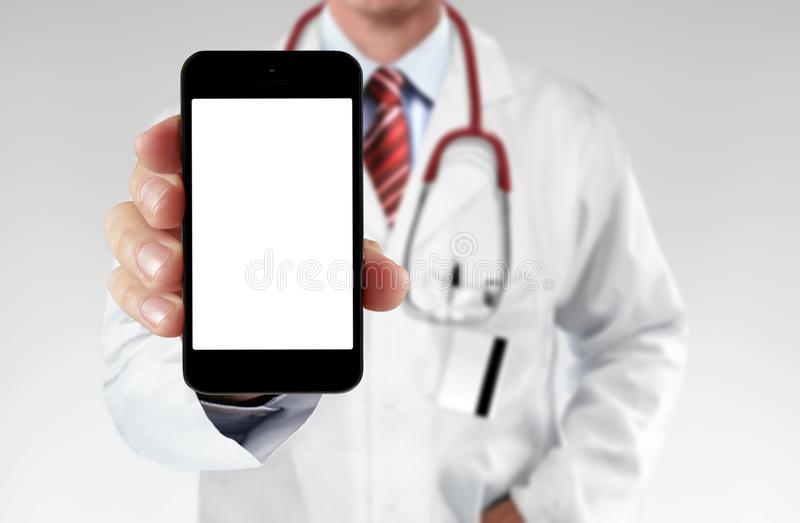 Doctor showing information on a smartphone. In close up stock photography
