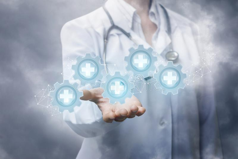 Doctor showing medical equipment group icons. Doctor showing medical equipment group icons on the background of the sky stock image