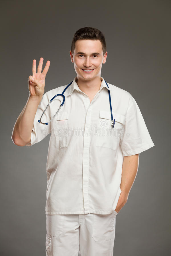 Doctor showing number three stock images