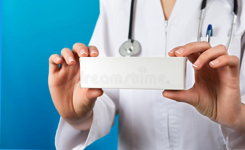 Doctor showing a pill packet to the patient royalty free stock photography