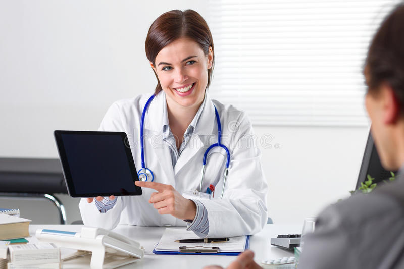 Doctor showing tablet to patient royalty free stock photos