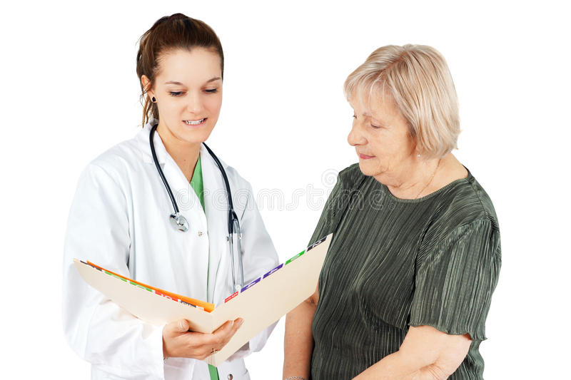 Doctor showing test results to senior
