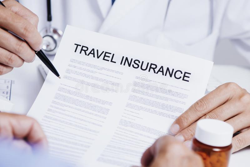 Doctor showing a travel insurance policy to a man royalty free stock photography