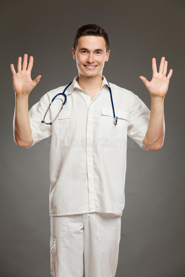 Doctor showing two open hands royalty free stock photography