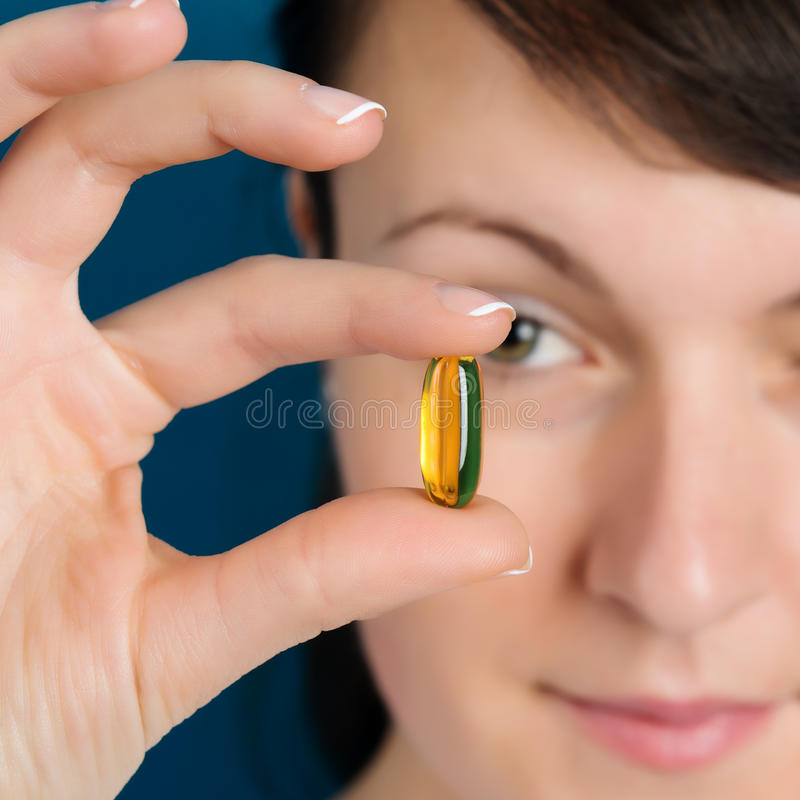 Doctor showing vitamin oil capsule. Doctor hand showing vitamin oil capsule royalty free stock photo