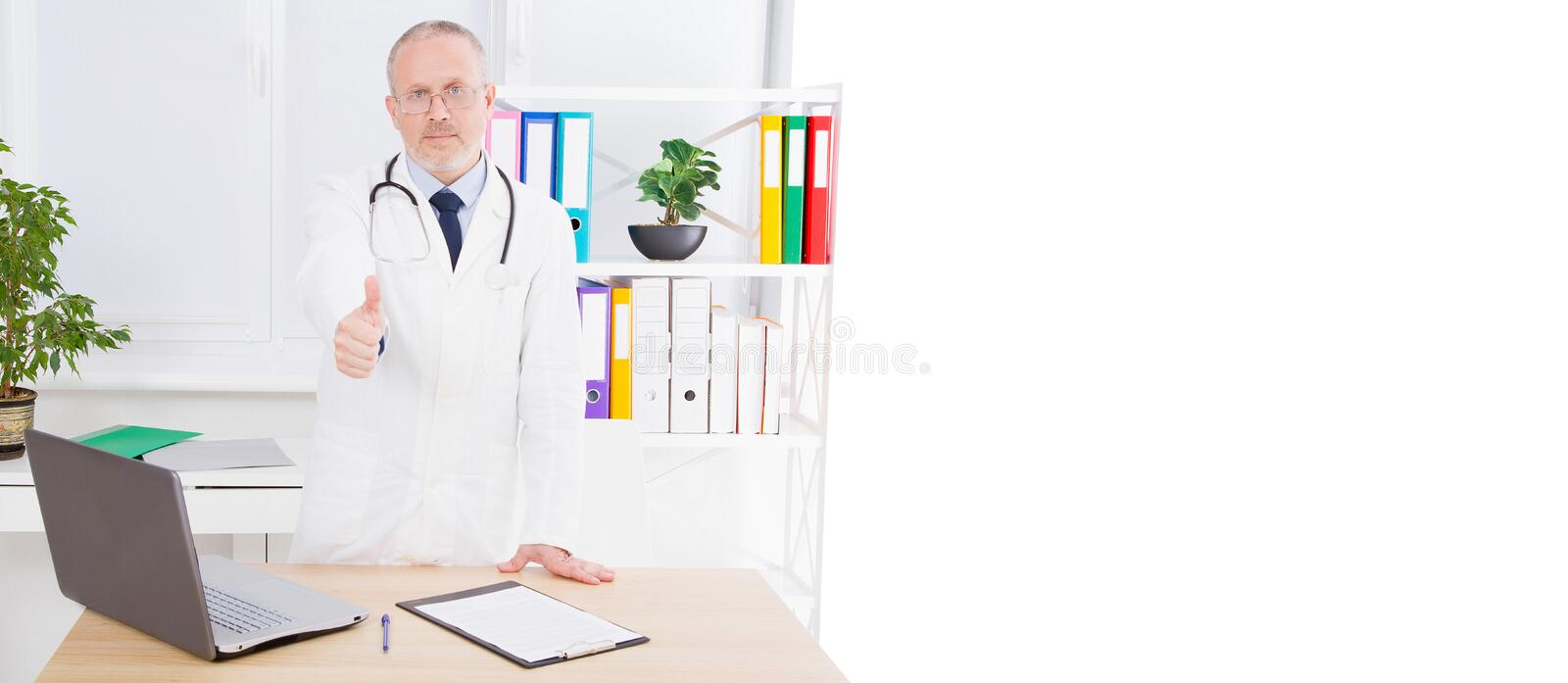 Doctor shows like in medical office, treating patients,copy space,billboard or banner royalty free stock images