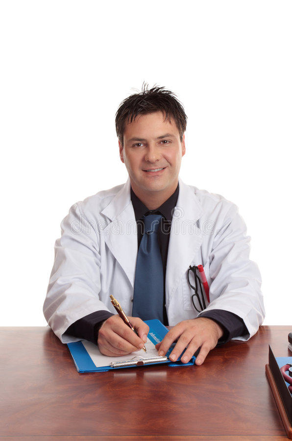 Doctor sitting at desk. Doctor or surgeon sitting at his desk with writing pen and form stock photo