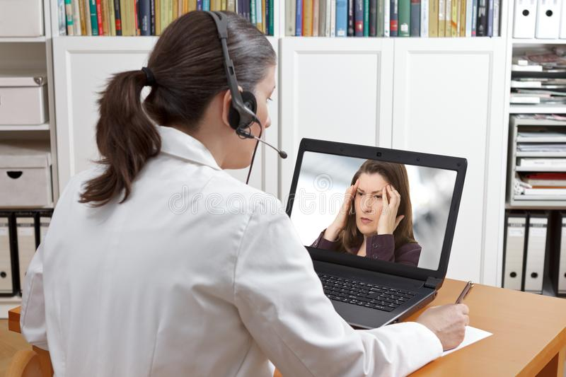 Doctor online call patient headache royalty free stock photos