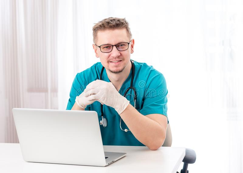 Doctor sitting in his cabinet royalty free stock photo