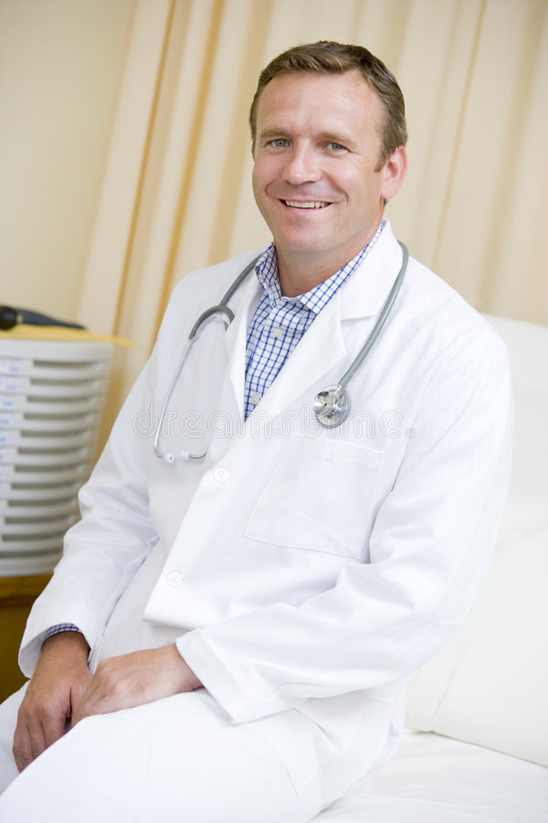 A Doctor Sitting On A Hospital Bed Stock Photos