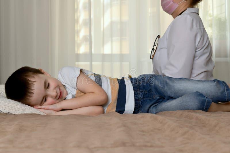 Doctor and sleeping baby. stock photo