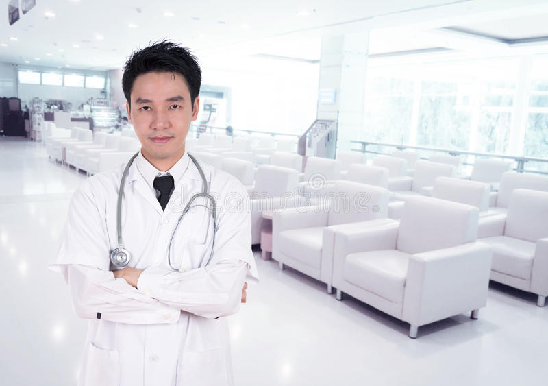 Doctor smiling with arms crossed stock photos