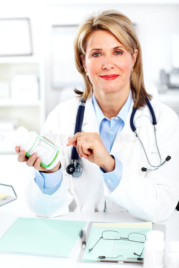 Doctor. Smiling medical doctor pharmacist. In a modern office stock photo