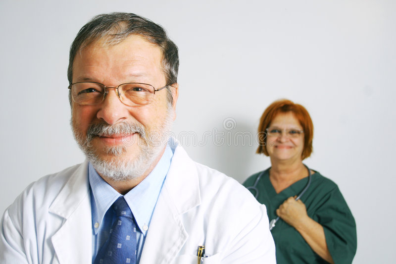 Doctor and smiling nurse royalty free stock photo
