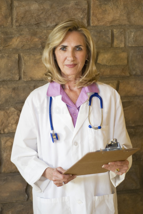 Doctor standing with charts royalty free stock photography