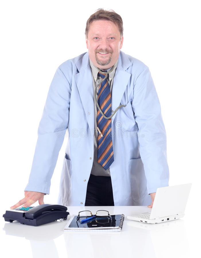 Doctor standing at desk royalty free stock photos