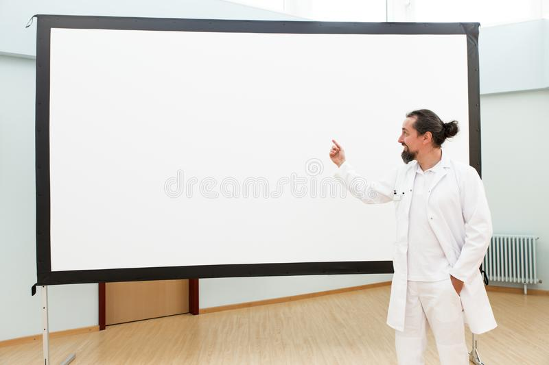 Doctor is standing in front of a empty whiteboard stock photos