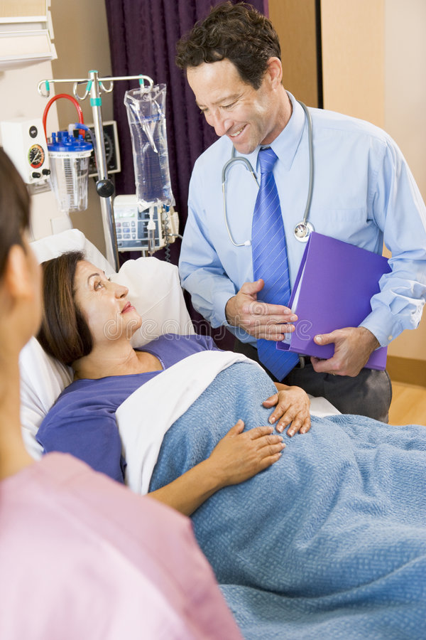 Download Doctor Standing In Hospital Room With His Patient Stock Image - Image: 6430487