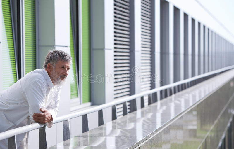 Download Doctor Standing On The Roof Of The Research Center Stock Photo - Image: 18432778