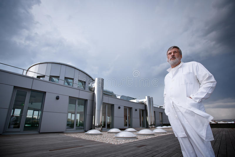 Download Doctor Standing On The Roof Of The Research Center Stock Image - Image of older, chemistry: 18432783