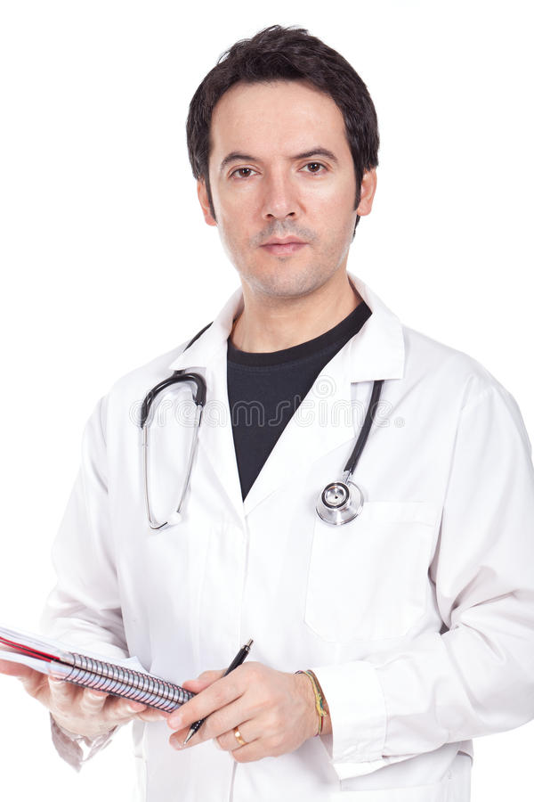 Doctor standing and writing a prescription stock photography