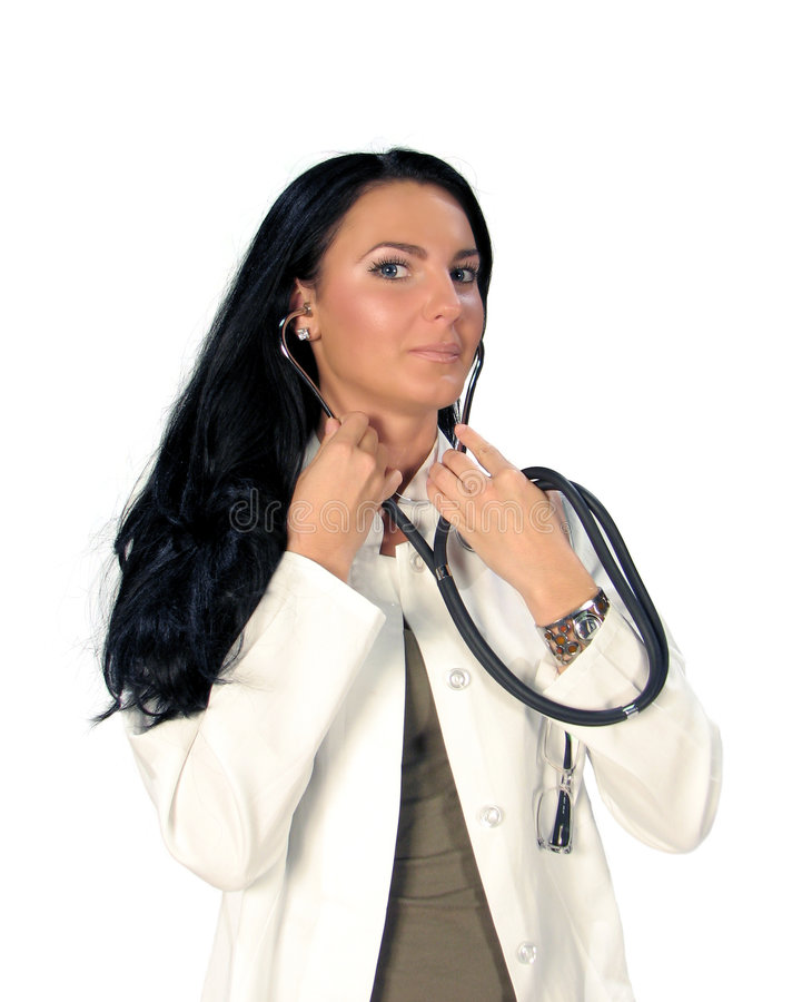 Doctor with stethoscope. Young pretty doctor with stethoscope on white royalty free stock photography